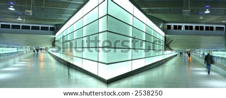 double walk way lit up by light wall - stock photo