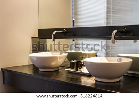 double washbasins decorated in bathroom - stock photo