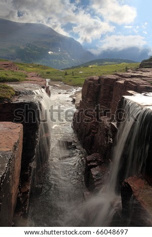 Double Waterfall in Glacier National Park, Montana. - stock photo