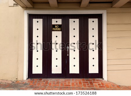 double white and brown wooden garage door with decorative studs - stock photo