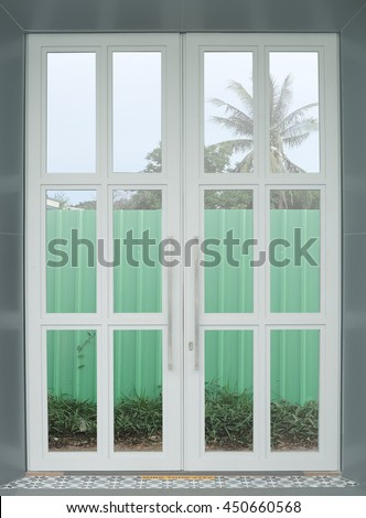Double white door with reflected mirror.