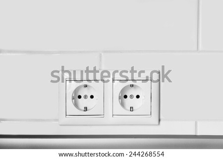 Double white socket on brick wall as a background - stock photo
