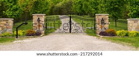 Double wrought-iron gate - stock photo