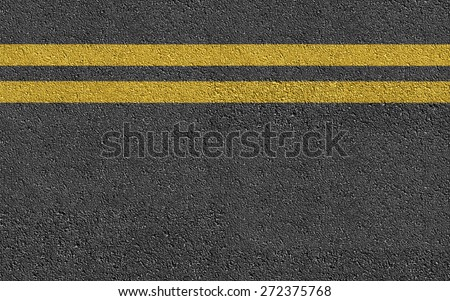 Double Yellow Line On New Asphalt Road texture background - stock photo