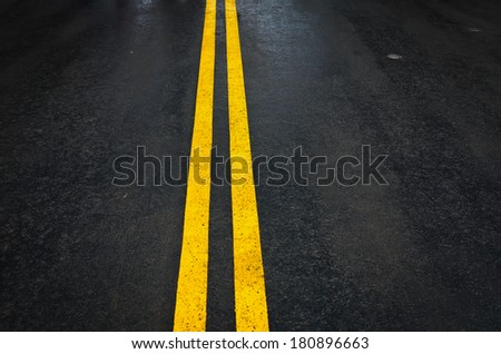 Double yellow lines on road background