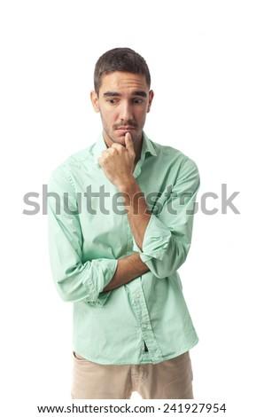 Doubtful man posing - stock photo