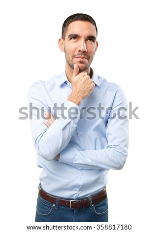 Doubtful young man - stock photo