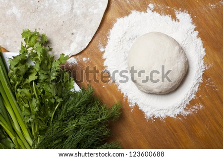Dough and lettuce - stock photo