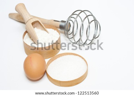 dough baking ingredients on white surface