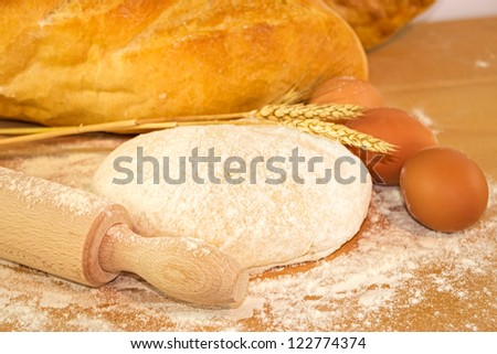 Dough for bread on wooden board - stock photo