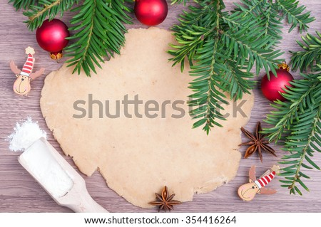 Dough for gingerbread, flour, anise star, Christmas tree and ornaments on the wooden background. Making Christmas cookies. Top view - stock photo
