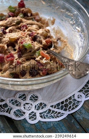 Dough for homemade muffins with dried fruit - stock photo