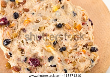 Dough for pie  on a wooden salver.  Photo can be used as a whole background.