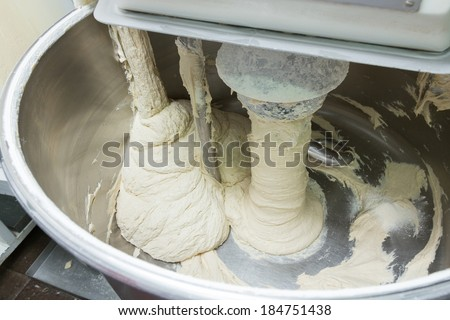 Dough kneading on a bread bakery production factory - stock photo