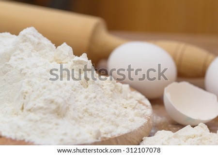 Dough preparation. Baking ingredients: egg and flour.
