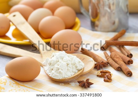Dough preparation. Baking ingredients: eggs, flour and spices. - stock photo