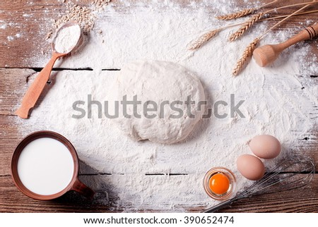 dough with flour and ingredients on the table - stock photo
