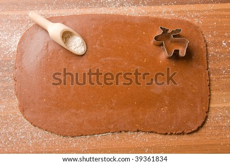 dough with flour and wooden spoon - stock photo