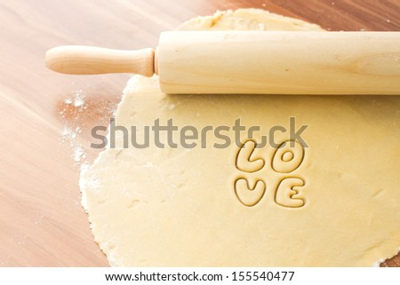 Dough with rolling, preparation for baking cookies, cut form love