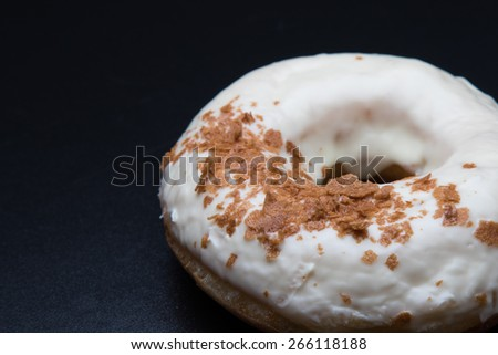 doughnut with sweet crispy on black table - stock photo