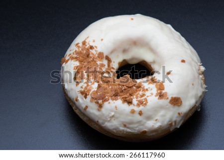 doughnut with sweet krispy on black table - stock photo