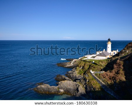Douglas Lighthouse on the Isle of Man with sea on sunny day - stock photo