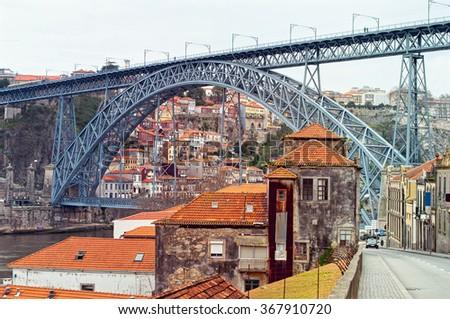 Douro River bank and the Dom Luis I Bridge in Porto, Portugal. UNESCO World Heritage. - stock photo