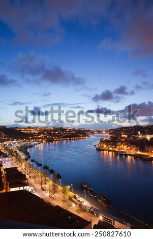 Douro river in the evening between cities of Vila Nova de Gaia and Porto in Portugal, view from above. - stock photo