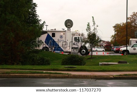DOVER, DE - OCTOBER 27: FEMA trucks and satellite equipment at a hotel ready for action after Hurricane Sandy on Sunday, October 27, 2012 in Dover, DE. - stock photo