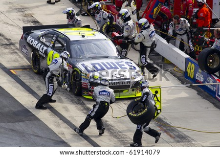 DOVER, DE - SEP 26:  Jimmie Johnson brings his Lowes Chevrolet in for service during the AAA 400 race at the Dover International Speedway in Dover, DE on Sep 26, 2010. - stock photo