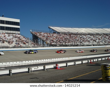 Dover,Delaware september 22 2007: The race cars waiting to restart the race for the nascar nextel cup at dover international speedway - stock photo