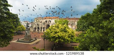 Doves flying over main square, Santo Domingo, Dominican Republic - stock photo