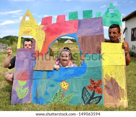 down syndrome couple and gypsy boy - stock photo