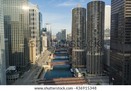 Down the Chicago River as the sun rises into the city.  Chicago, Illinois, U.S.A - stock photo