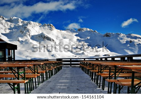 downhill ski resort building on a mountain slope in winter - stock photo