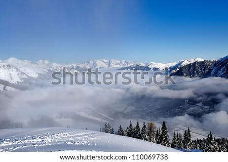 downhill ski slope at sunny winter day - stock photo