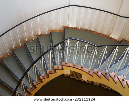 Downside view of a spiral staircase classical desgin architecture element - stock photo