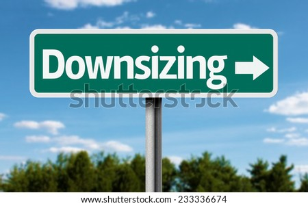 Downsizing creative green sign - stock photo