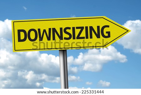 Downsizing creative sign on the clouds background - stock photo
