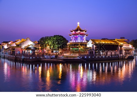 Downtown area of a Chinese city, Suzhou, in China,  at blue hour.  The city has a nick name:  paradise on earth.  - stock photo