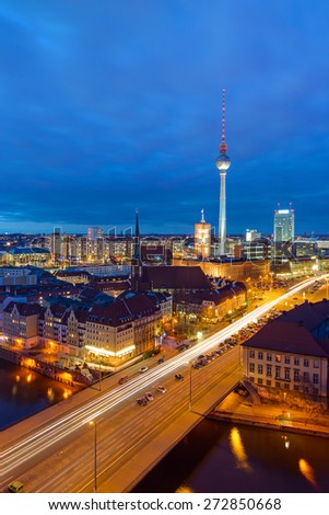 Downtown Berlin with the famous television tower at night - stock photo