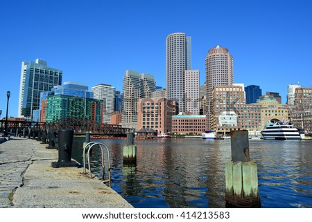 Downtown Boston skyline as seen from the Seaport District harbor walk.