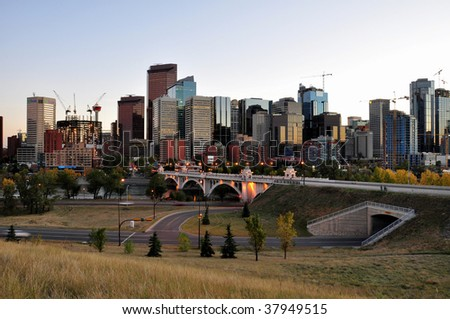 downtown Calgary, Alberta, Canada in the evening. Bow Tower under construction can be seen on the left. - stock photo