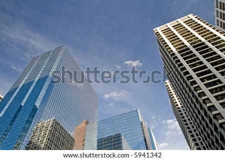 Downtown Calgary office buildings soaring into the skyline while gleaming in the sun - stock photo