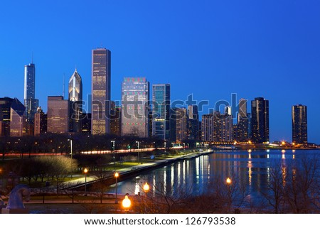 Downtown Chicago across Lake Michigan at dusk, IL, USA - stock photo