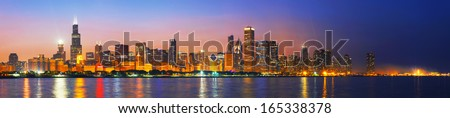 Downtown Chicago, IL at sunset as seen from Lake Michigan - stock photo