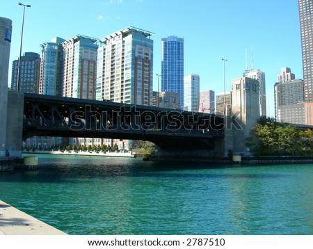 Downtown Chicago, Illinois from Chicago River, with bridge in foreground - stock photo