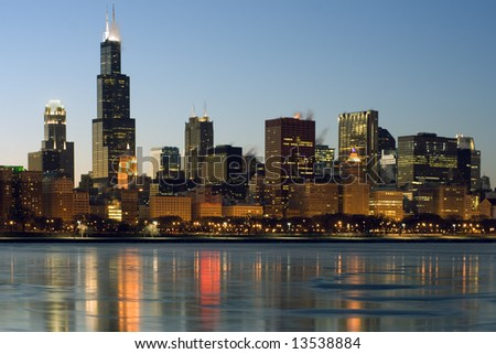 Downtown Chicago reflected in frozen Lake Michigan. - stock photo