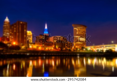 Downtown Cleveland Ohio as seen from the west bank of the Cuyahoga River at blue hour, blurred for artistic effect - stock photo