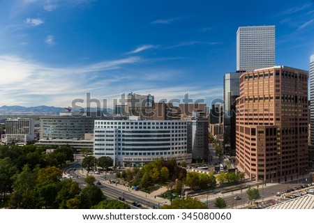 Downtown Denver With Close Up of Skyscrapers and Blue Summer Sky - stock photo